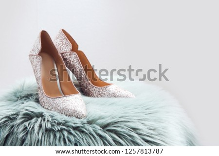 d0e76179f6 Stylish female shoes on fur against light background. Space for text  #1257813787 · Beautiful silver glitter high heel ...