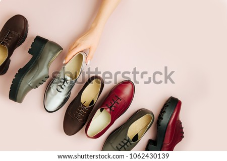 Stylish female spring or autumn shoes in various colors. Beauty and fashion concept. Flat lay, top view #1062430139