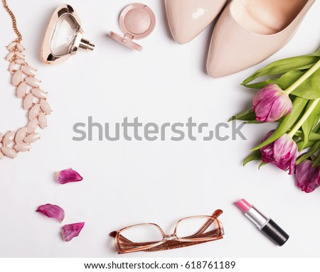 Stylish feminine accessories and pink tulips, top view  #618761189