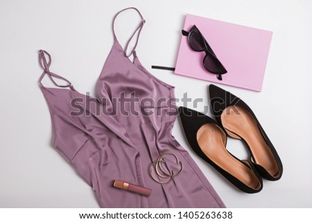Stylish feminine accessories isolated on white background. Modern fashion flat lay with light top, suede shoes and other accessories