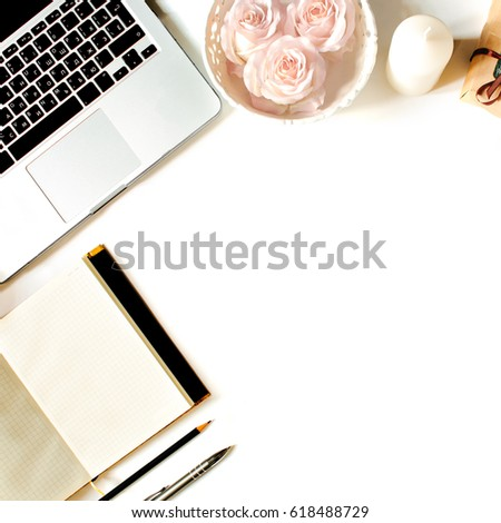 Stylish feminine work place. White office desk table with laptop, roses, vintage white tray, notebook, coffee cup, pen and pencil. Top view with copy space, flat lay #618488729