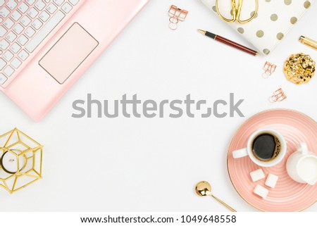 Stylish flatlay frame arrangement with pink laptop, coffee, milk holder, planner, glasses and other accessories. Feminine business mockup, copyspace, white background #1049648558
