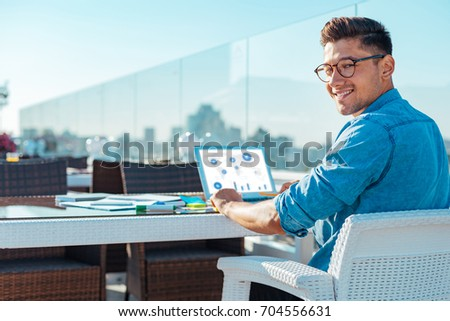 Stylish freelancer looking into camera with smile