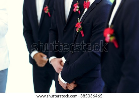 Stylish friends of the groom at the wedding  ceremony