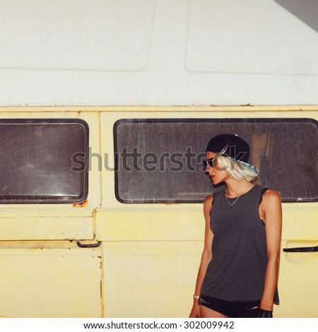 Stylish Girl stands near Minibus. Surf Fashion style