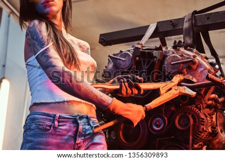 Female mechanic at work  auto service station, working girl