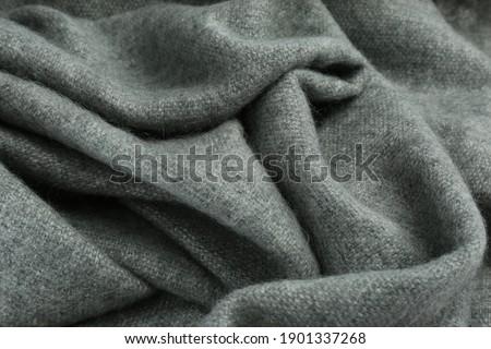 Stylish grey cashmere scarf as background, closeup ストックフォト ©