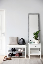 Stylish hallway interior with large mirror