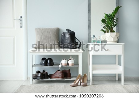 Stylish hallway interior with large mirror #1050207206