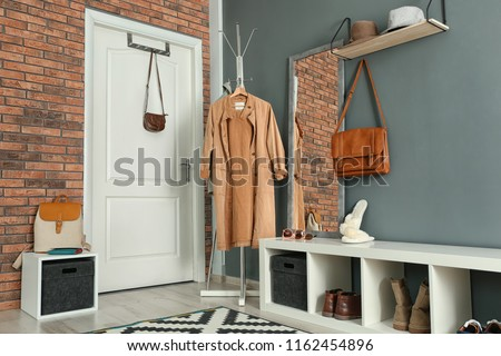 Stylish hallway interior with mirror and hanger stand #1162454896