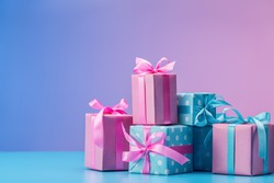 Stylish handmade gift boxes decorated with ribbons and bows. Gifts in pink and blue packaging. Copy space.