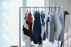 Stylish hanger clothes, female clothes on white room. Women's shirt and blouses on a hanger. Fashion blog for entrepreneurs, bloggers, magazines, websites, social media.