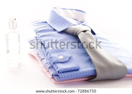 Stylish image of two formal men's shirts with a bottle of scent