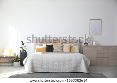 Stylish interior of contemporary room with comfortable bed Foto d'archivio ©