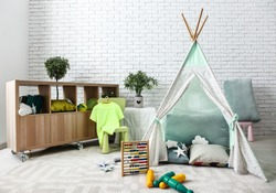 Stylish interior of kid room with hovel