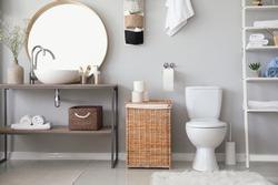 Stylish interior of modern bathroom with toilet bowl