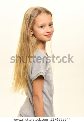 stylish kid. stylish kid with long blond hair. stylish kid isolated on white. stylish kid and beauty fashion