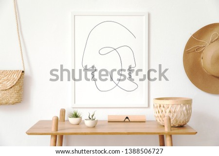 Stylish korean interior of living room with white mock up poster frame, elegant accessories, wooden shelf and hanging rattan bag and hat. Minimalistic concept of home decor. Template. Bright room.