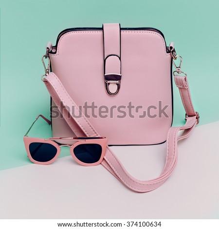 Stylish Ladies Accessories. Sunglasses & Handbag. Focus on Pastel Colors.