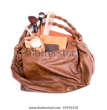 Stylish ladies\' handbag with cosmetics and notebooks