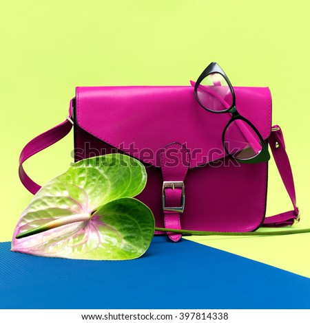 Stylish Lady Crimson Accessories. Bag and eyeglasses.
