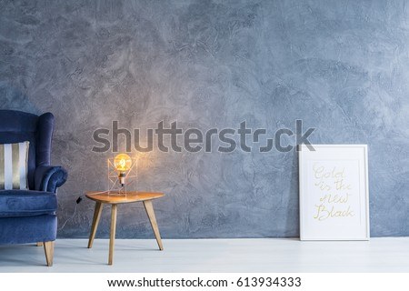 Stylish lamp on a wooden table in modern designed room #613934333