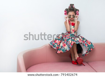 Stylish little girl portrait with hair curlers and sunglasses, kid's fashion #791402674