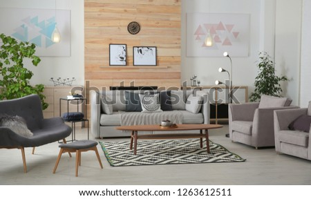 Stylish living room interior with comfortable couch and decorative elements #1263612511