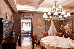 Stylish luxury classical interior of a dining room or a restaurant. Brown warm colors wooden interior design