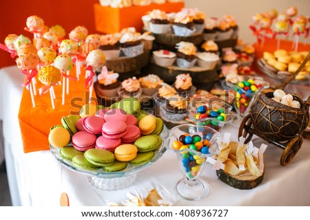 stylish luxury decorated orange candy bar for the celebration of a wedding of happy couple, cathering in the restaurant