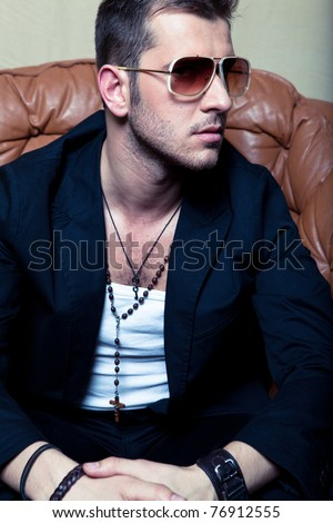 Stylish man in a jacket and sunglasses