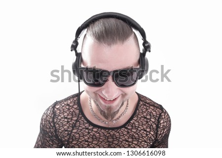 stylish man in a stylish dark glasses listening to music.