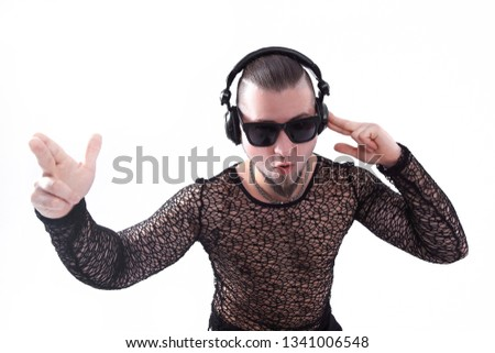 stylish man in a stylish dark glasses listening to music.