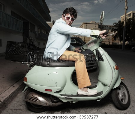 Stylish man on a scooter