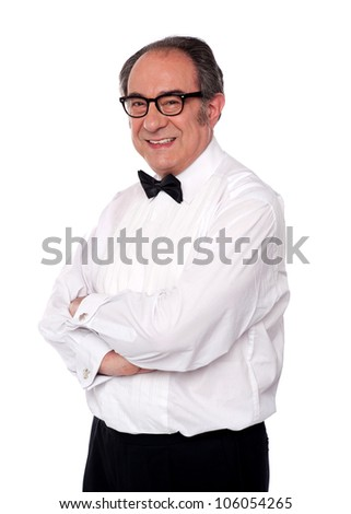 Stylish man posing with crossed arms against white