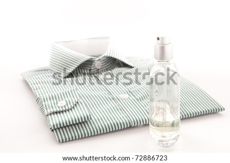 Stylish man's shirt with a bottle of scent