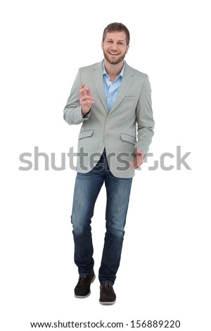 Stylish man smiling and gesturing at the camera on white background