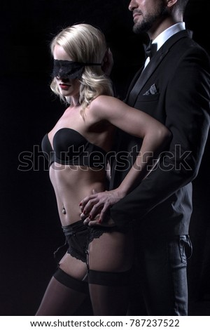 Stylish man touching sexy blonde lover in blindfold closeup, sensuality and foreplay #787237522