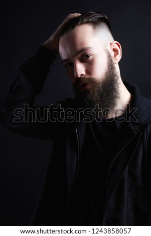 Stylish Man with stylish haircut. handsome Boy, Brutal bearded hipster. Barber Shop