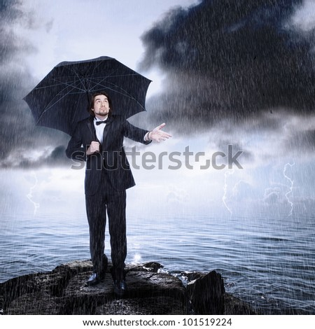 Stylish Man with Umbrella Checking for Rain (storm clearing or coming)