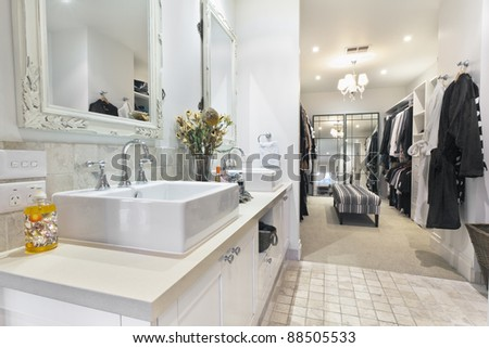 Stylish master bathroom with twin sinks and spacious walk in robe