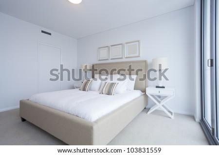 Stylish master bedroom in new Australian apartment.