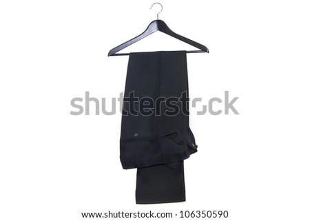 Stylish men's black pants on a hanger isolated on white background
