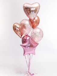 Stylish metallic pink balloons for Valentine's day, hen party or baby shower on a white background.