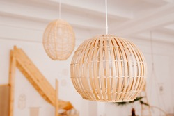 stylish minimalist bamboo chandeliers on the ceiling