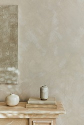 Stylish minimalistic monochromatic composition with design vases and personal accessories. Poster on the wall. Copy space. Neutral colors. Template.