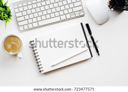 Stylish minimalistic workplace with keyboard, notebook, office plant, notebook, glasses in flat lay style. White background. Top view. #723477571