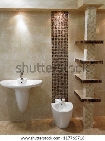 Stylish modern bathroom with shower, sink and toilet
