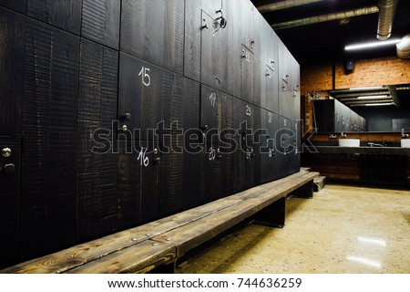Shutterstock Stylish modern comfortable spacious locker room. Interior, nobody. Expensive quality materials, luxury. Loft design dressing room.