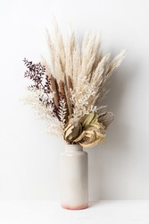 Stylish modern dried flower arrangement in a cream and pink vase. Including Banksia, pampas grass, bulrush and ruscus leaves. Art decoBoho gift for Anniversary, birthday, mothers day.